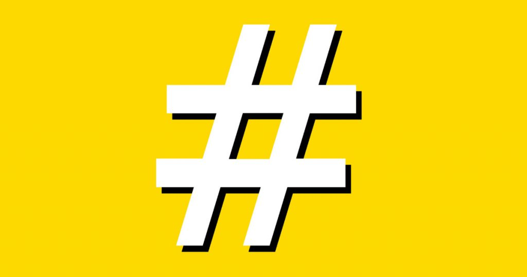 A white hashtag on a yellow background