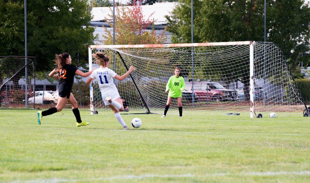 Women Shooting Football